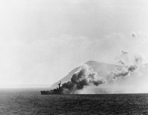 HMS PLYMOUTH on fire after being attacked by five Argentine Mirage aircraft on 8 June 1982