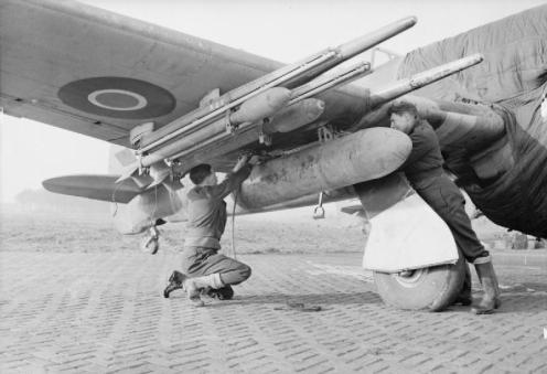 Hawker_Typhoon_fuel_tank_fitting_WWII_IWM_CL_1725