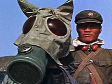 Chinese soldier and his horse prepare to participate in exercises during a nuclear test