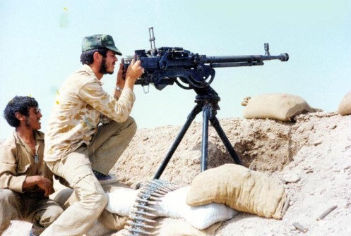 Iranian_soldier_shooting_with_DShk