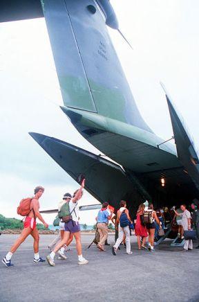 American_students_board_a_C-141B__Operation_Urgent_Fury_